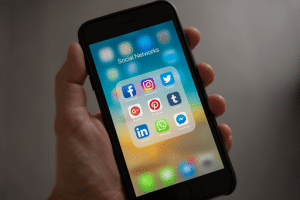 close up image of a cellphone screen with social media apps