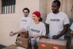 group of volunteers handing out bottles of water