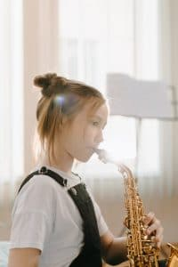 young girl playing the saxaphone