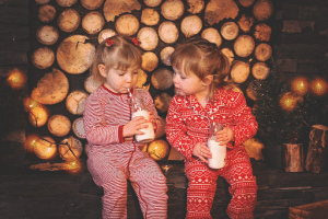 two young girls in red pajamas