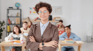 principal standing in front of a classroom full of students