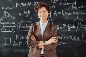 principal in front of a chalkboard