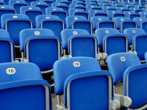 row of blue empty stadium seats
